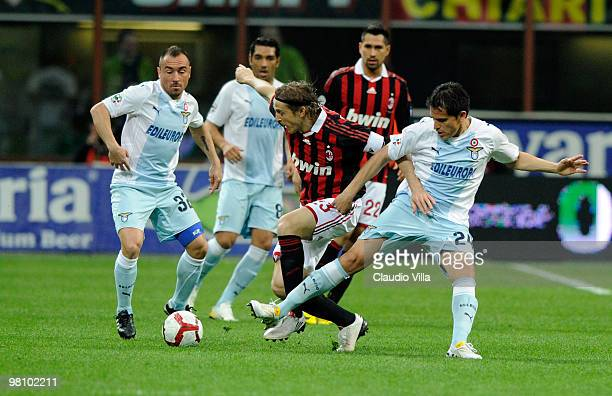 Massimo Ambrosini of AC Milan competes for the ball with Cristian Ledesma of SS Lazio during the Serie A match between AC Milan and SS Lazio at...