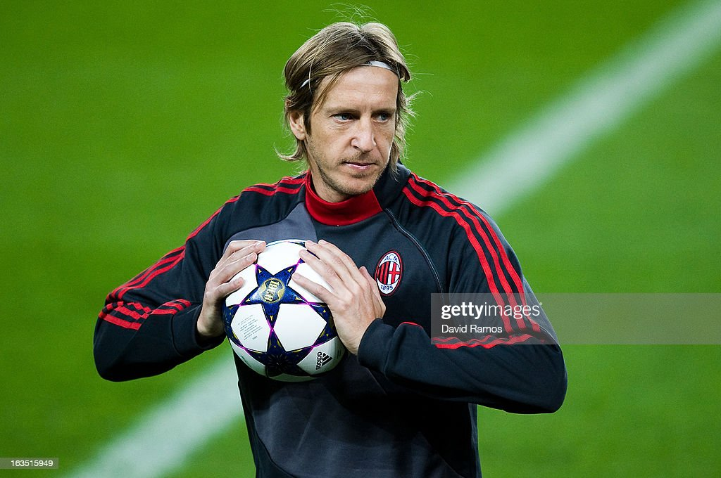 <a gi-track='captionPersonalityLinkClicked' href=/galleries/search?phrase=Massimo+Ambrosini&family=editorial&specificpeople=227979 ng-click='$event.stopPropagation()'>Massimo Ambrosini</a> of AC Milan holds the ball during the training session ahead of their UEFA Champions League round of 16 second leg against FC Barcelona at the Camp Nou Stadium on March 11, 2013 in Barcelona, Spain.Ê