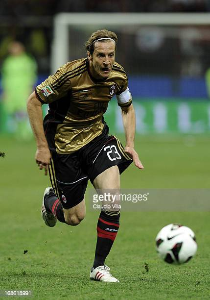 Massimo Ambrosini of AC Milan in action during the Serie A match between AC Milan and AS Roma at San Siro Stadium on May 12 2013 in Milan Italy