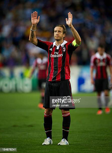 Massimo Ambrosini of AC Milan reacts to the AC Milan fans at the end of the UEFA Champions League group C match between Malaga CF and AC Milan at the...
