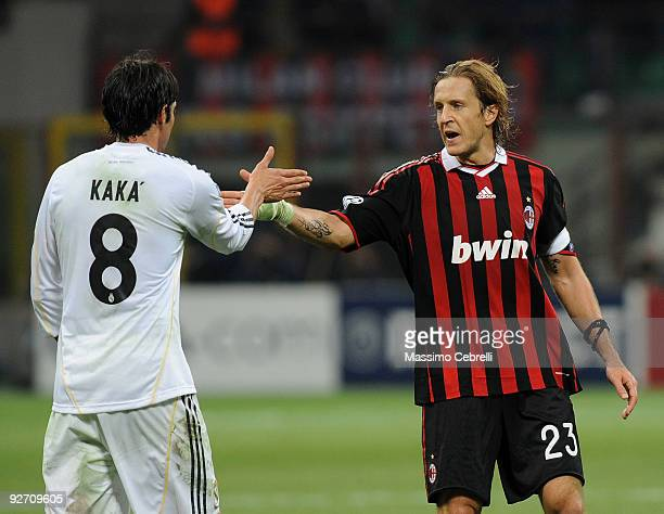 Massimo Ambrosini of AC Milangives five with Ricardo Kaka of Real Madrid after the UEFA Champions League group C match between AC Milan and Real...