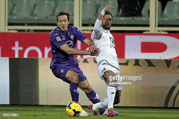 Massimo Ambrosini of ACF Fiorentina fights for the ball with Luca Antonini of Genoa CFC during the Serie A match between ACF Fiorentina and Genoa CFC...
