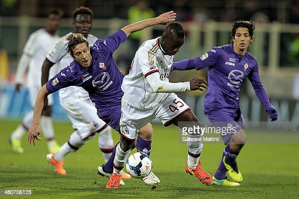 Massimo Ambrosini of ACF Fiorentina fights for the ball with Mario Balotelli of AC Milan during the serie A match between ACF Fiorentina and AC Milan...