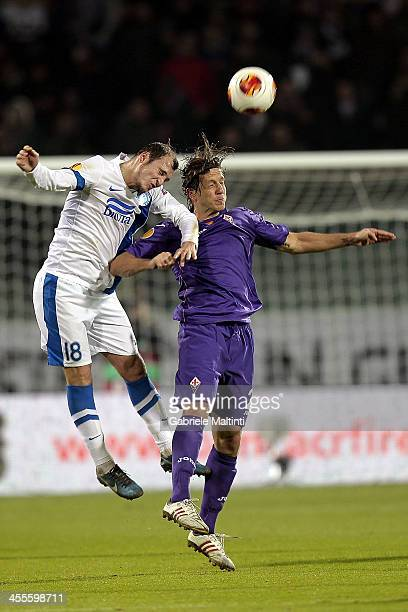 Massimo Ambrosini of ACF Fiorentina fights for the ball with Roman Zozulya of FC Dnipro Dnipropetrovsk during the Uefa Europa League Group E match...