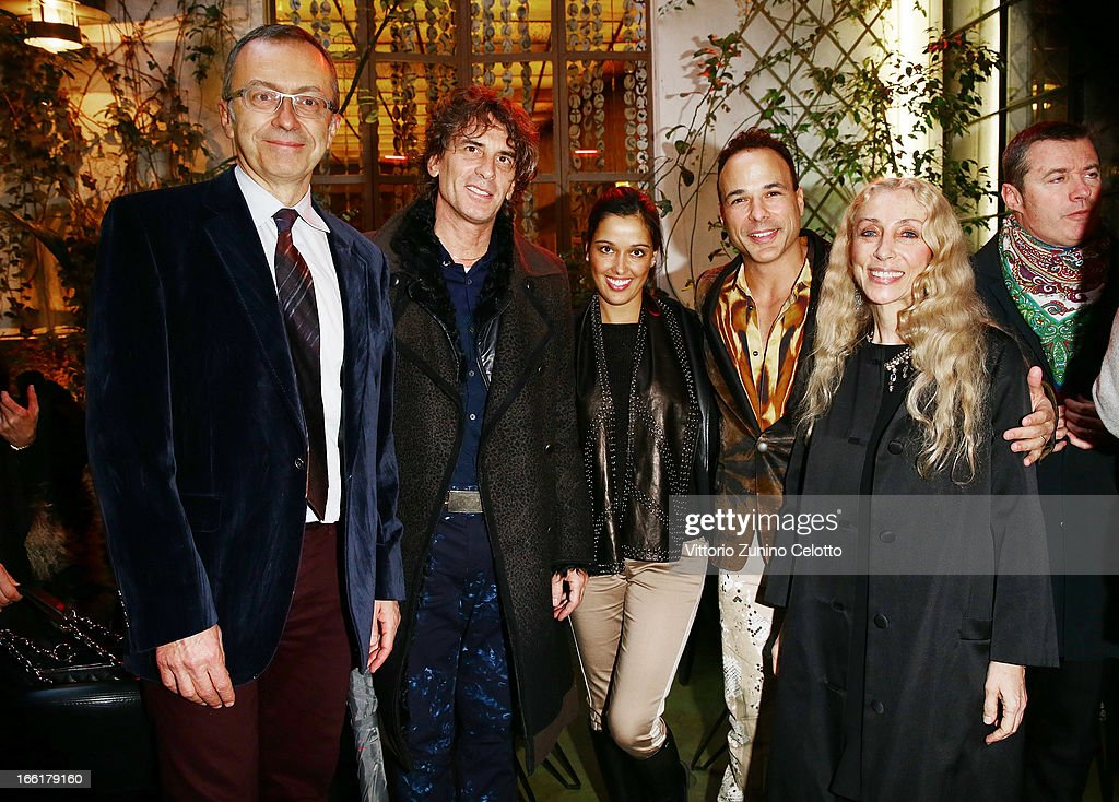 Massimo Borio, Franca Sozzani and the artists of the Cirque du soleil attend Citroen DS Sofa and DS3 Cabrio L'Uomo Vogue Limited Edition cocktail at Corso Como 10 on April 9, 2013 in Milan, Italy.