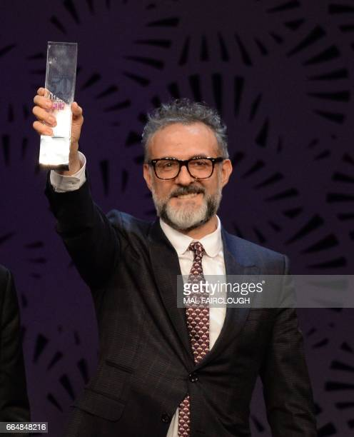 Massimo Bottura of Osteria Francescana in Italy holds his trophy after winning the Best Restaurant in Europe award at the World's 50 Best Restaurants...