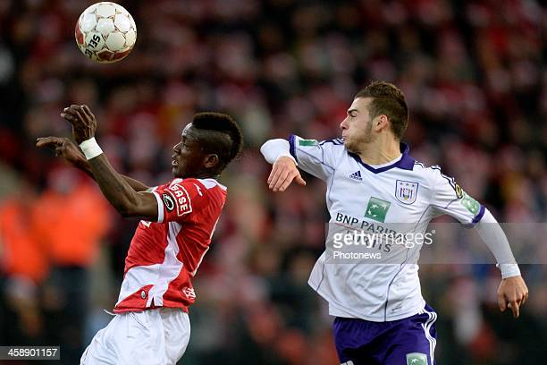 Massimo Bruno of RSC Anderlecht battles for the ball with Daniel Opare of Standard during the Jupiler League match between Standard Liege and RSC...