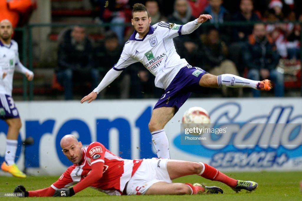 Massimo Bruno of RSC Anderlecht battles for the ball with Laurent Ciman of Standard during the Jupiler League match between Standard Liege and RSC Anderlecht on December 22, 2013 in Liege, Belgium.