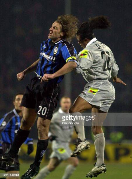 Massimo CARRERA of Atalanta and Edgar DAVIDS of Juventus compete for the ball during the SERIE A 17th Round League match between Atalanta and...