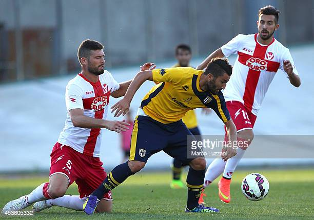 Massimo Coda of FC Parma competes for the ball with Martino Borghese of AS Varese during the preseason friendly match between AS Varese and FC Parma...