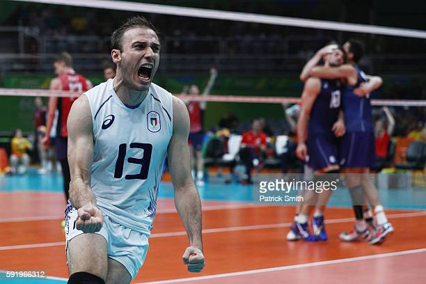 Massimo Colaci of Italy celebrates a point over the United States during the Men's Volleyball Semifinal match on Day 14 of the Rio 2016 Olympic Games...