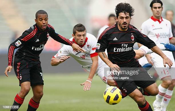Massimo Donati of Bari competes for the ball with Gennaro Gattuso and Robinho of Milan during the Serie A match between Bari and Milan at Stadio San...