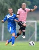 Massimo Donati of Palermo and Roman Joos of Selezione Alta Val Venosta compete for the ball during a preseason friendly match between US Citta di...