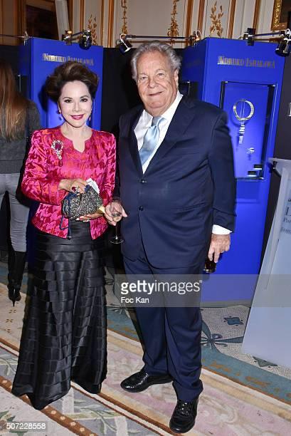 Massimo GargiaÊand Dewi Sukarno attend the Nobuku Ishikawa Jewellery Exhibition Cocktail at Le Meurice as part of Paris Fashion Week on January 27...