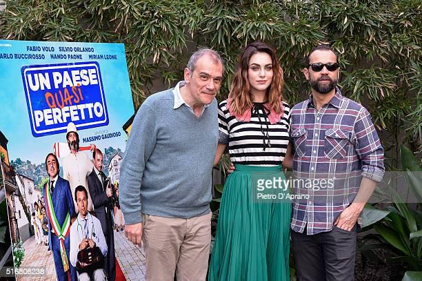 Massimo Gaudioso Fabio Volo Miriam Leone attends a photocall for 'Un Paese Quasi Perfetto' on March 21 2016 in Milan Italy