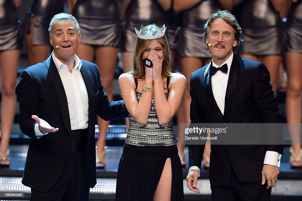 Massimo Ghini, Cesare Bocci and Newly elected 19-year-old Giulia Arena is crowned with the title of Miss Italia 2013 during the final of the beauty pageant contest 2013 at the Pala Arrex on October 27, 2013 in Jesolo, Italy.