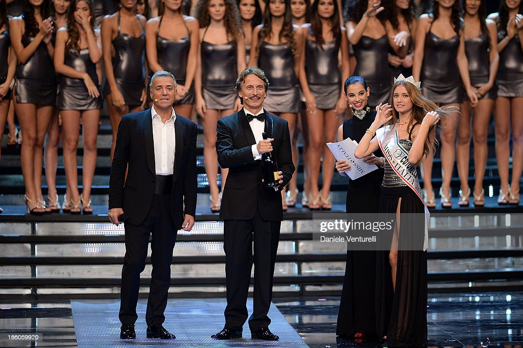Massimo Ghini, Cesare Bocci, Francesca Chillemi and Newly elected 19-year-old Giulia Arena is crowned with the title of Miss Italia 2013 during the final of the beauty pageant contest 2013 at the Pala Arrex on October 27, 2013 in Jesolo, Italy.