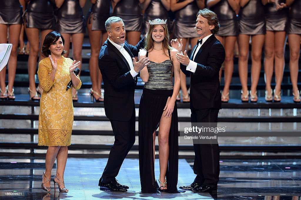 Massimo Ghini, Cesare Bocci, Patrizia Mirigliani and Newly elected 19-year-old Giulia Arena is crowned with the title of Miss Italia 2013 during the final of the beauty pageant contest 2013 at the Pala Arrex on October 27, 2013 in Jesolo, Italy.