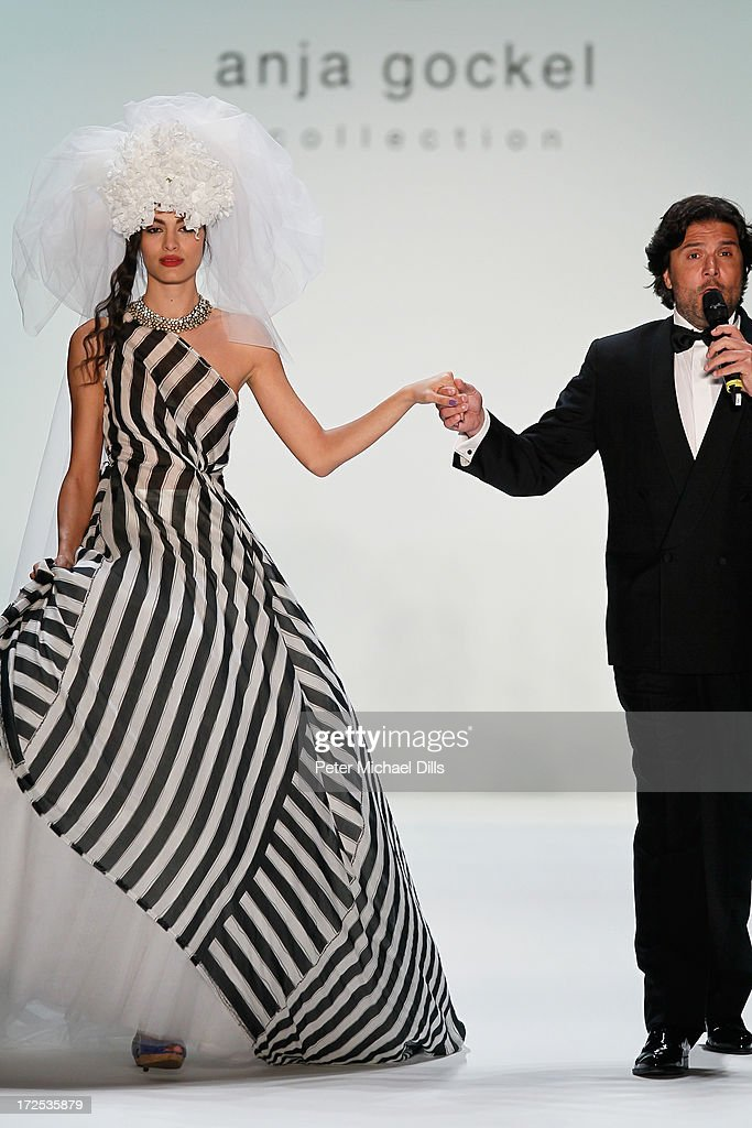 Massimo Giordano and a model walk the runway at Anja Gockel show during Mercedes-Benz Fashion Week Spring/Summer 2014 at Brandenburg Gate on July 3, 2013 in Berlin, Germany.