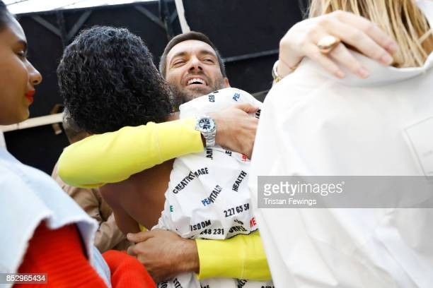 Massimo Giorgetti and a model are seen backstage ahead of the MSGM show during Milan Fashion Week Spring/Summer 2018on September 24 2017 in Milan...