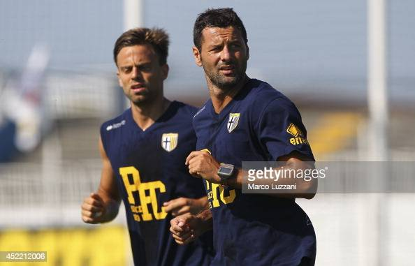 Massimo Gobbi and Daniele Galloppa of Parma run during FC Parma Training Session at the club's training ground on July 16 2014 in Collecchio Italy