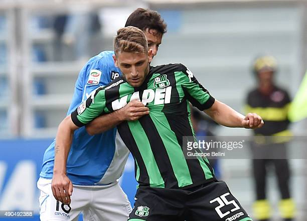 Massimo Gobbi of Chievo Verona and Domenico Berardi of Sassuolo in action during the Serie A match between US Sassuolo Calcio and AC Chievo Verona at...