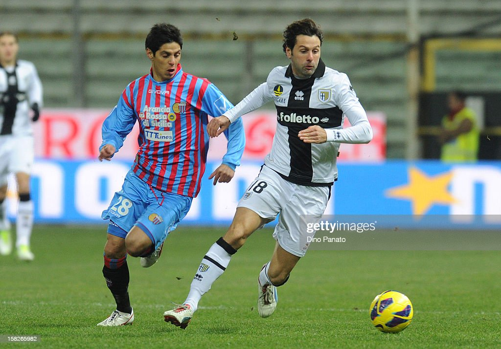 Massimo Gobbi (R) of Parma FC competes with Pablo Cesar Barientos of Catania Calcio during the TIM Cup match between Parma FC and Catania Calcio at Stadio Ennio Tardini on December 12, 2012 in Parma, Italy.
