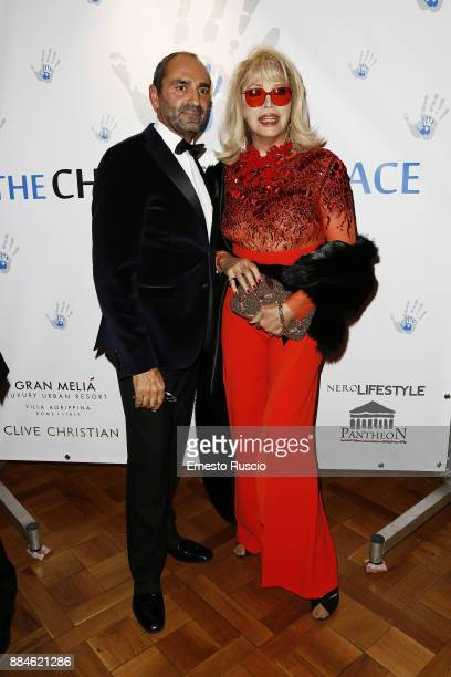 Massimo Leonardelli and Amanda Lear arrive for the Children for Peace Gala Dinner at Cardinal Gallery on December 2 2017 in Rome Italy