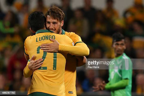 Massimo Luongo congratulates Mathew Leckie of Australia after scoring during the 2018 FIFA World Cup Qualification match between the Australian...