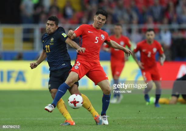 Massimo Luongo of Australia and Francisco Silva of Chile battle for possession during the FIFA Confederations Cup Russia 2017 Group B match between...