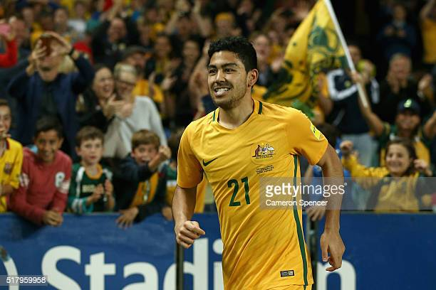 Massimo Luongo of Australia celebrates after scoring a goal during the 2018 FIFA World Cup Qualification match between the Australian Socceroos and...