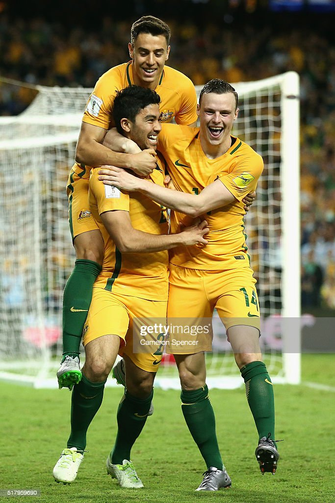 Massimo Luongo of Australia celebrates scoring a goal with team mates Christopher Ikonomidis and Brad Smith during the 2018 FIFA World Cup Qualification match between the Australian Socceroos and Jordan at Allianz Stadium on March 29, 2016 in Sydney, Australia.