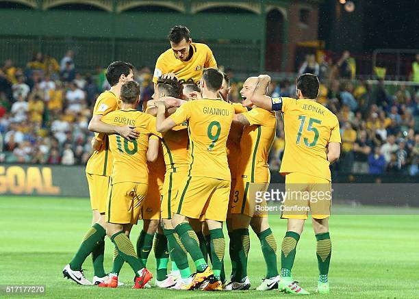 Massimo Luongo of Australia celebrates with team mates after scoring a goal during the 2018 FIFA World Cup Qualification match between the Australia...