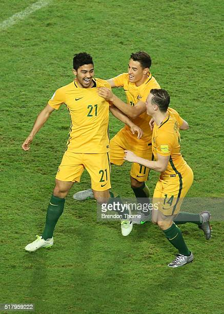 Massimo Luongo of Australia celebrates with team mates Christopher Ikonomidis and Brad Smith after scoring a goal during the 2018 FIFA World Cup...