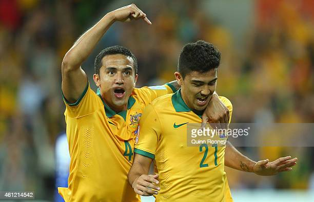 Massimo Luongo of Australia is congratulated by Tim Cahill after scoring a goal during the 2015 Asian Cup match between the Australian Socceroos and...