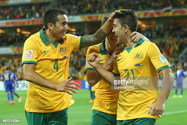 Massimo Luongo of Australia is congratulated by Tim Cahill and Robbie Kruse after scoring a goal during the 2015 Asian Cup match between the...