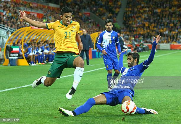 Massimo Luongo of Australia is tackled by Khaled Alqahtani of Kuwait during the 2015 Asian Cup match between the Australian Socceroos and Kuwait at...
