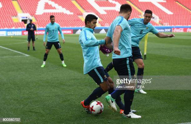 Massimo Luongo of Australia tackles Bailey Wright during a training session at the Spartak Stadium during the FIFA Confederations Cup Russia 2017 on...