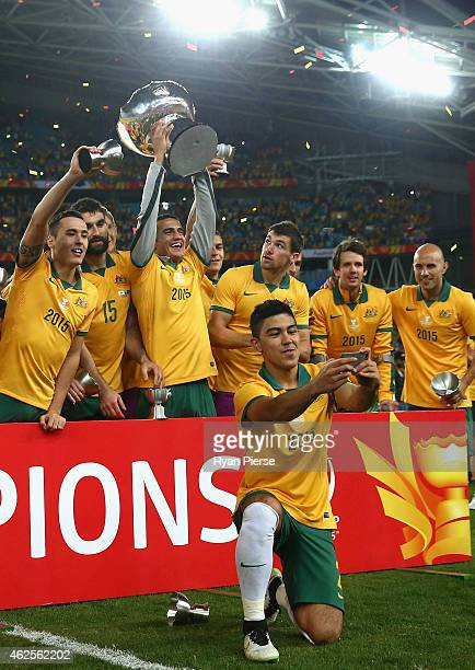 Massimo Luongo of Australia talkes a selfie as Australia celebrate during the 2015 Asian Cup final match between Korea Republic and the Australian...
