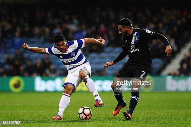 Massimo Luongo of Queens Park Rangers holds off the challenge of Liam Feeney of Blackburn Rovers during the Emirates FA Cup Third Round match between...