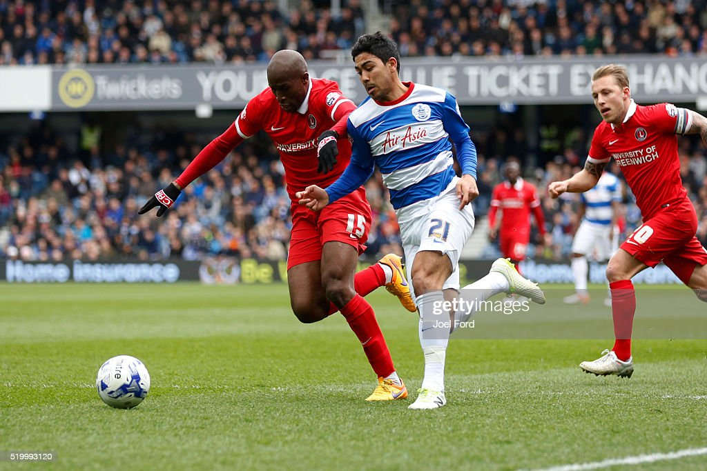 Massimo Luongo of Queens Park Rangers takes on Rod Fanni of Charlton Athletic during the Queens Park Rangers v Charlton Athletic Sky Bet Championship...