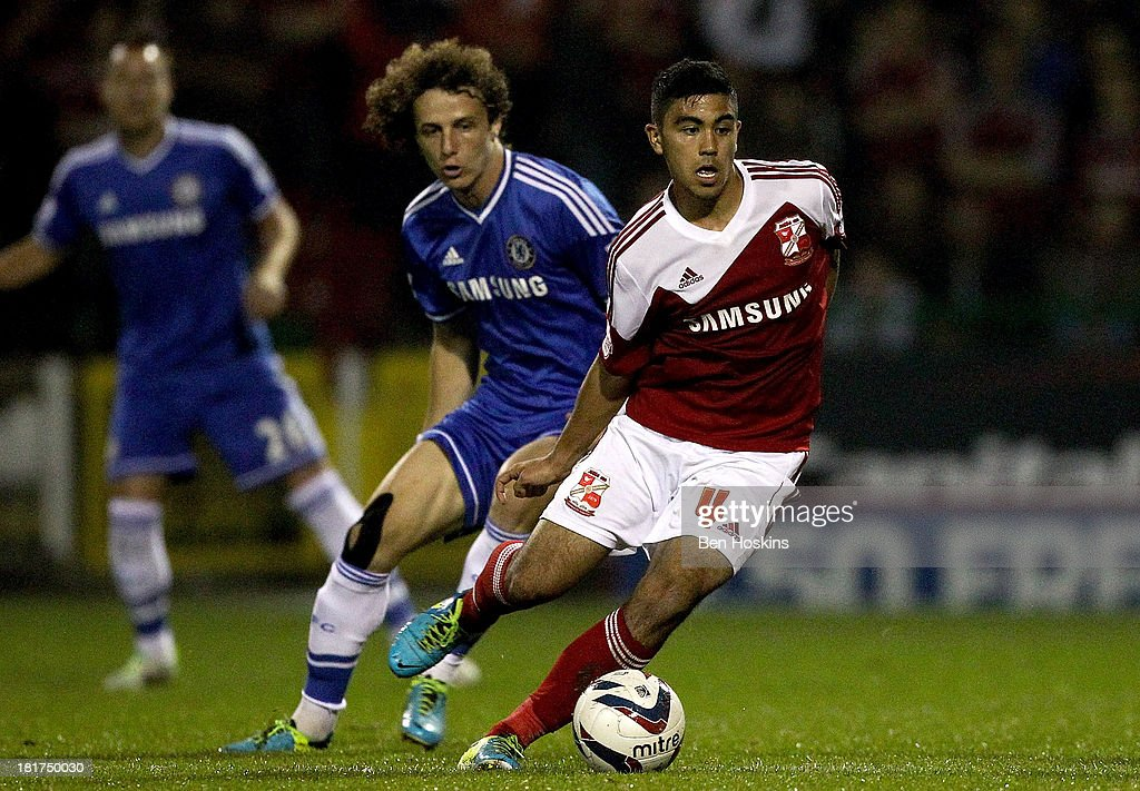 Massimo Luongo of Swindon holds off pressure from <a gi-track='captionPersonalityLinkClicked' href=/galleries/search?phrase=David+Luiz&family=editorial&specificpeople=4133397 ng-click='$event.stopPropagation()'>David Luiz</a> of Chelsea during the Capital One Cup third round match between Swindon Town and Chelsea at County Ground on September 24, 2013 in Swindon, England.