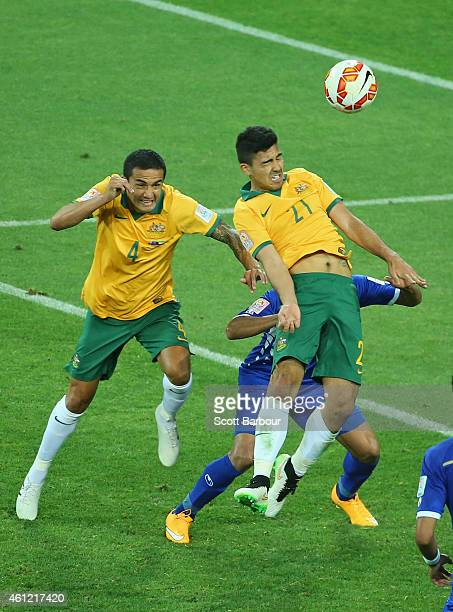 Massimo Luongo of the Socceroo heads the ball to score a goal as Tim Cahill looks on during the 2015 Asian Cup match between the Australian Socceroos...