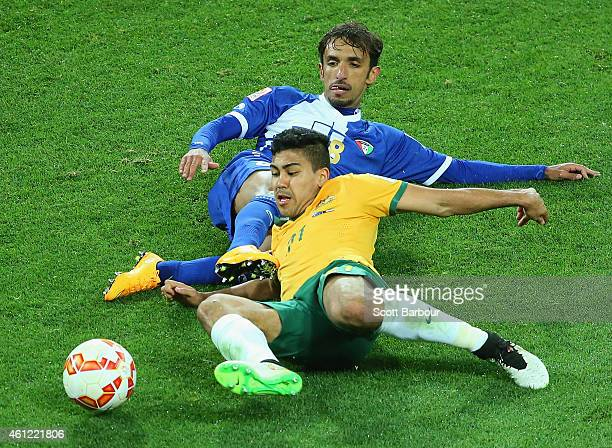 Massimo Luongo of the Socceroos and Saleh Sheikh Alhendi of Kuwait compete for the ball during the 2015 Asian Cup match between the Australian...