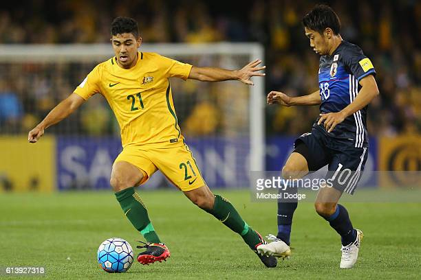 Massimo Luongo of the Socceroos and Shinji Kagawa of Japan compete for the ball during the 2018 FIFA World Cup Qualifier match between the Australian...