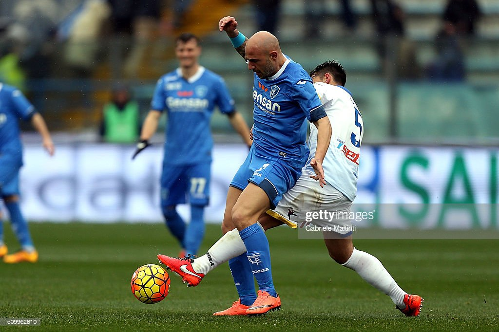 <a gi-track='captionPersonalityLinkClicked' href=/galleries/search?phrase=Massimo+Maccarone&family=editorial&specificpeople=204389 ng-click='$event.stopPropagation()'>Massimo Maccarone</a> of Empoli FC battles for the ball with Adriano Russo of Frosinone Calcio during the Serie A match between Empoli FC and Frosinone Calcio at Stadio Carlo Castellani on February 13, 2016 in Empoli, Italy.