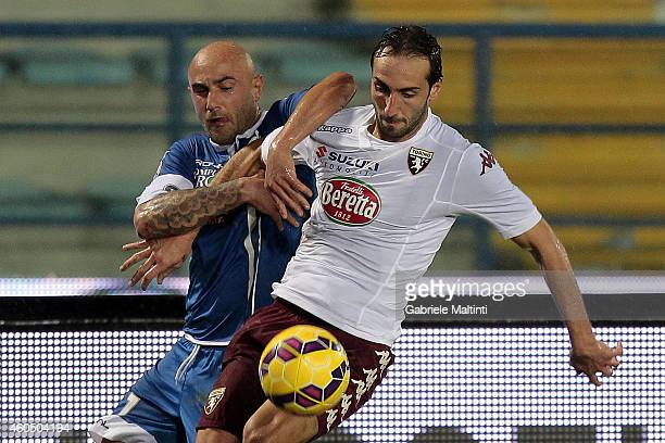 Massimo Maccarone of Empoli FC battles for the ball with Alessaandro Moretti of Torino FC during the Serie A match between Empoli FC and Torino FC at...