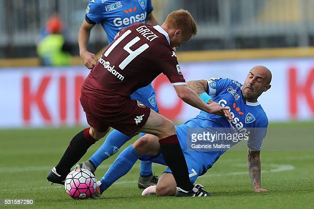Massimo Maccarone of Empoli FC battles for the ball with Alessandro Gazzi of Torino FC during the Serie A match between Empoli FC and Torino FC at...