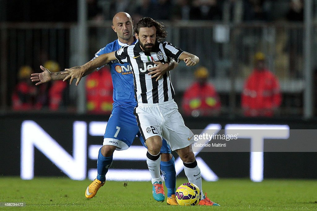 Massimo Maccarone of Empoli FC battles for the ball with Andrea Pirlo of Juventus FC during the Serie A match between Empoli FC and Juventus FC at Stadio Carlo Castellani on November 1, 2014 in Empoli, Italy.