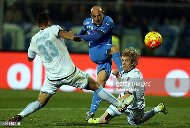 Massimo Maccarone of Empoli FC battles for the ball with Dos Santos Mauricio and Dusan Basta of SS Lazio during the Serie A match between Empoli FC...